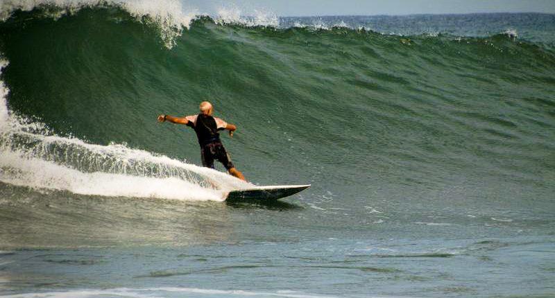 Local board shaper Bruce surfs the Troncones beach break