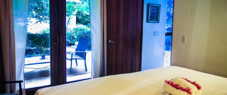 Casa Oasis Troncones vacation rental downstairs two bedroom beach house garden bedroom